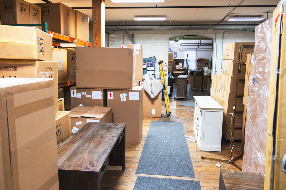 Boxes of furniture wait to be unpacked amid the weeklong store renovation.