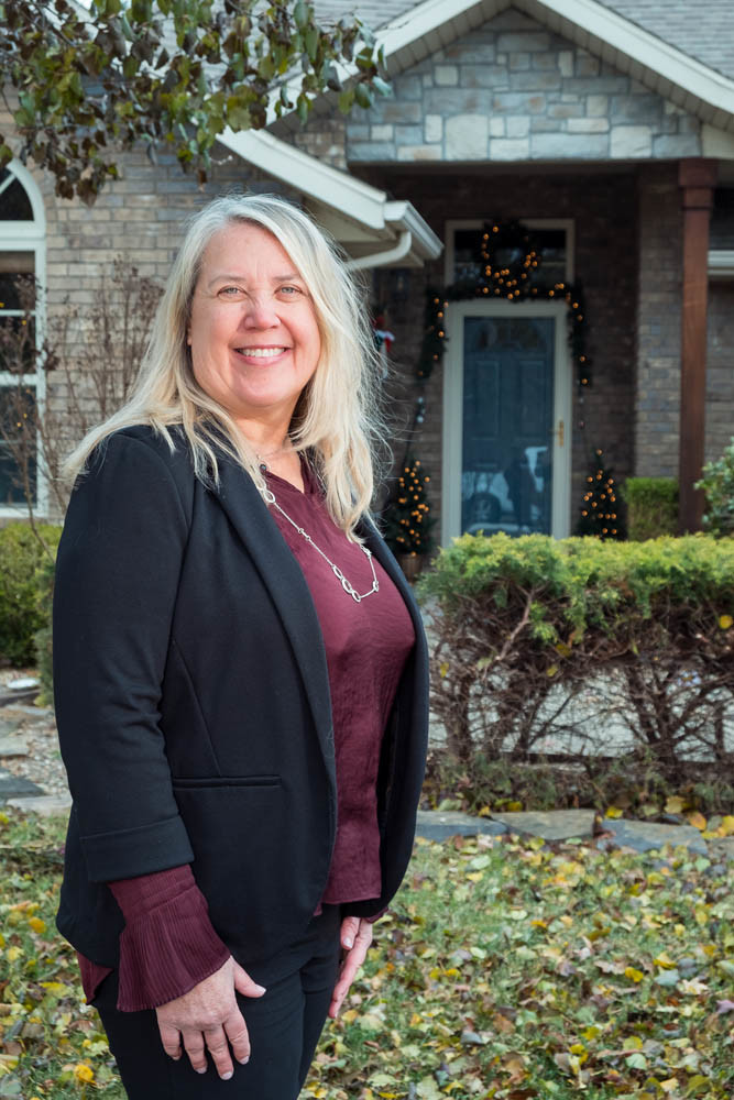 IN THE ACADEMY: Yvonne Burdette-Van Camp stands outside a home she recently sold in the Oak Grove neighborhood. She is a member of the next Leadership Academy of Realtors.