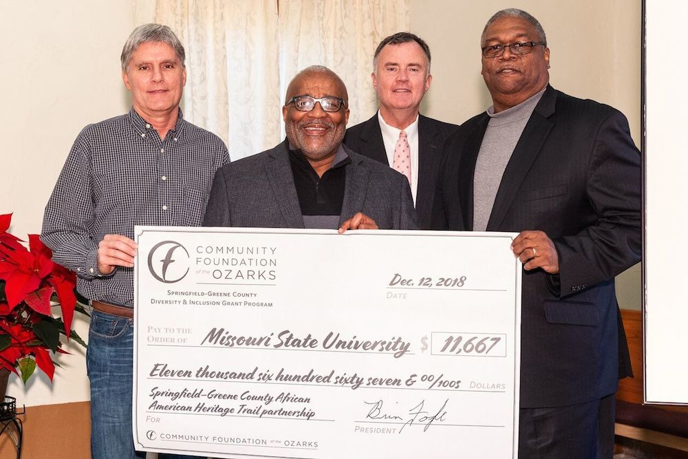 CFO President Brian Fogle, second from right, presents a check to Tim Knapp, left, Lyle Foster and West Pratt, right.