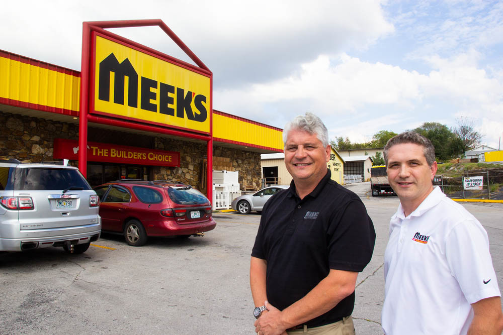 Despite selling in September, Meek's Lumber Co. retains its name and management. Charlie, left, and Mike Meek are pictured outside a store.