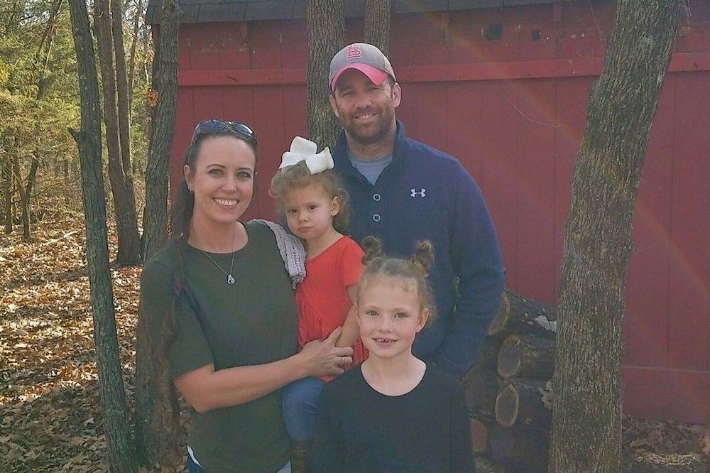 Scott Rothrock, pictured with his wife and two daughters, died Dec. 28.