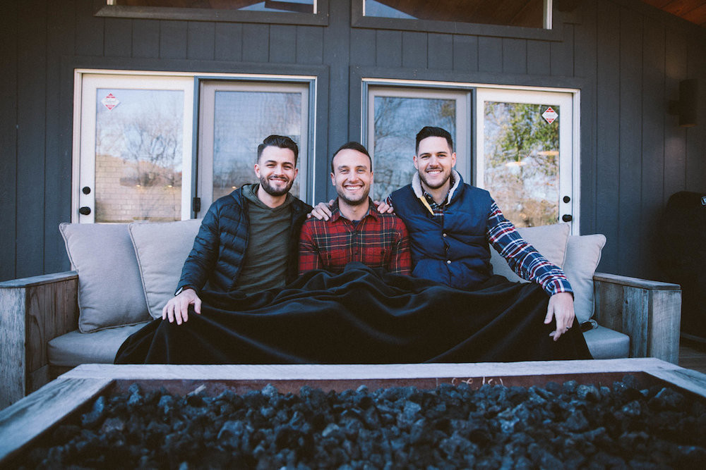 From left, Josh Stewart, Bryan Simpson and Dane Watts demonstrate Big Blanket Co.'s flagship product.
