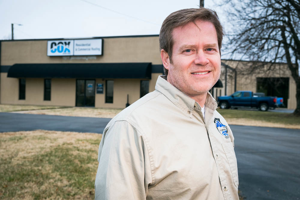 RAISING THE ROOF: President Ken Mills says Cox Roofing plans to add 10 employees in 2019, its 40th year in business.