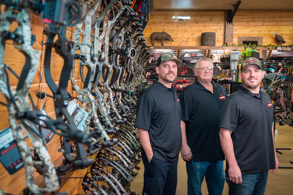 BOWS ABOUND: Midwest Archery's brick-and-mortar store north of town is the first for the Williams family, left to right, Jason Greg and Brad.