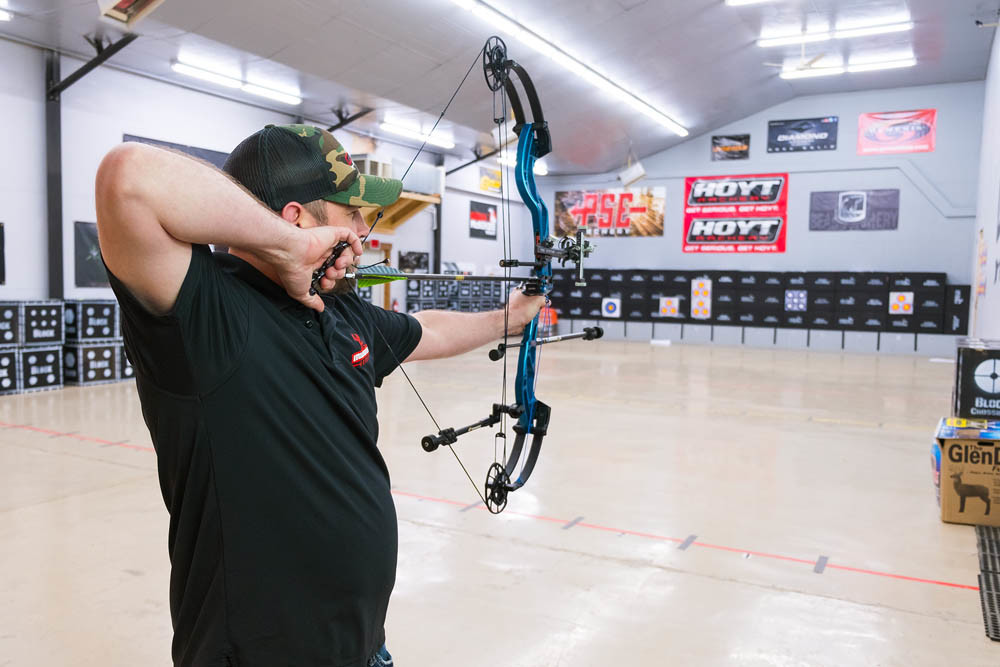 Brad Williams draws his bow at Midwest Archery's 10-lane range.