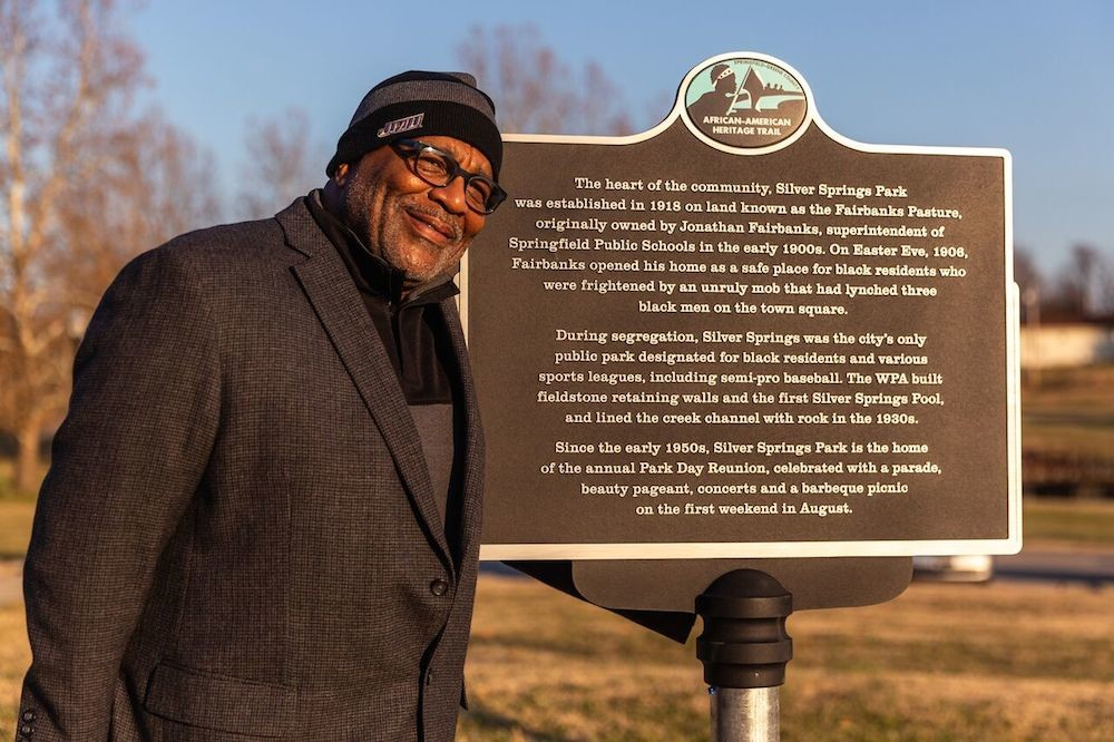 Business owner and MSU professor Lyle Foster stands by the first in a series of planned markers for a trail honoring Springfield's African-American heritage.