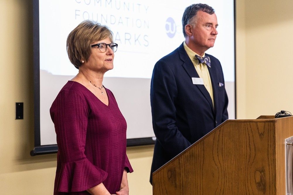Multipli Credit Union President Judy Hadsall and Community Foundation of the Ozarks CEO Brian Fogle announce the program on Monday.