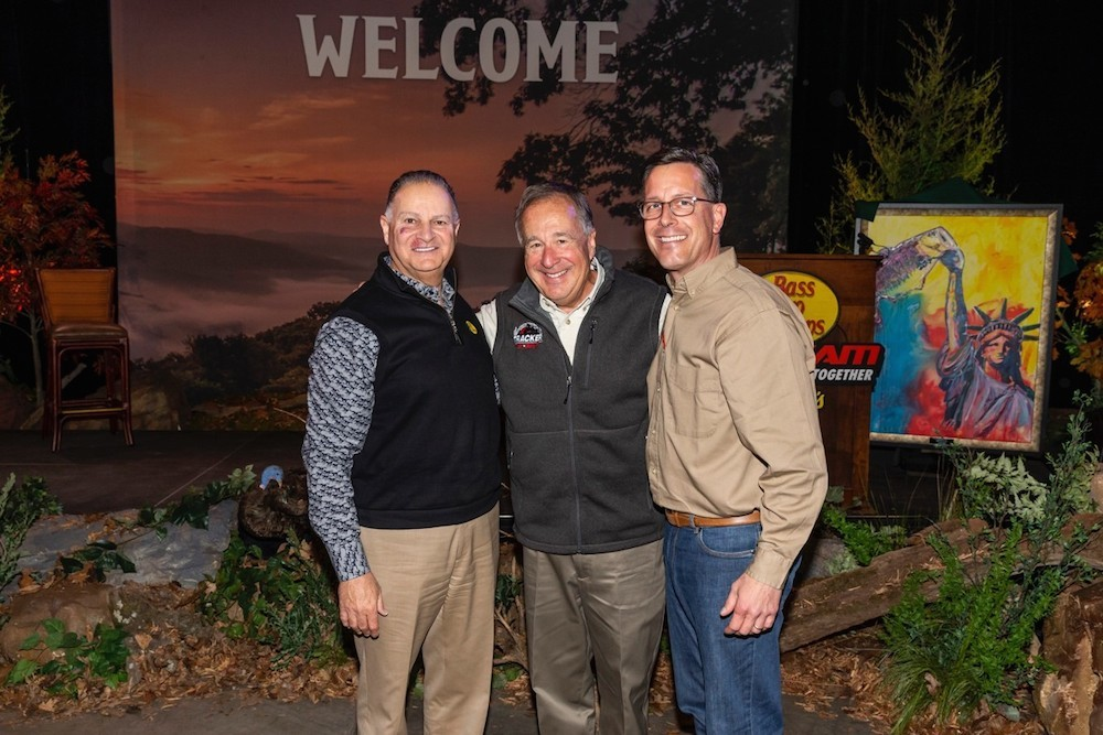 Bass Pro founder Johnny Morris, center, poses with Jim Hagale, left, and Michael McDermott.