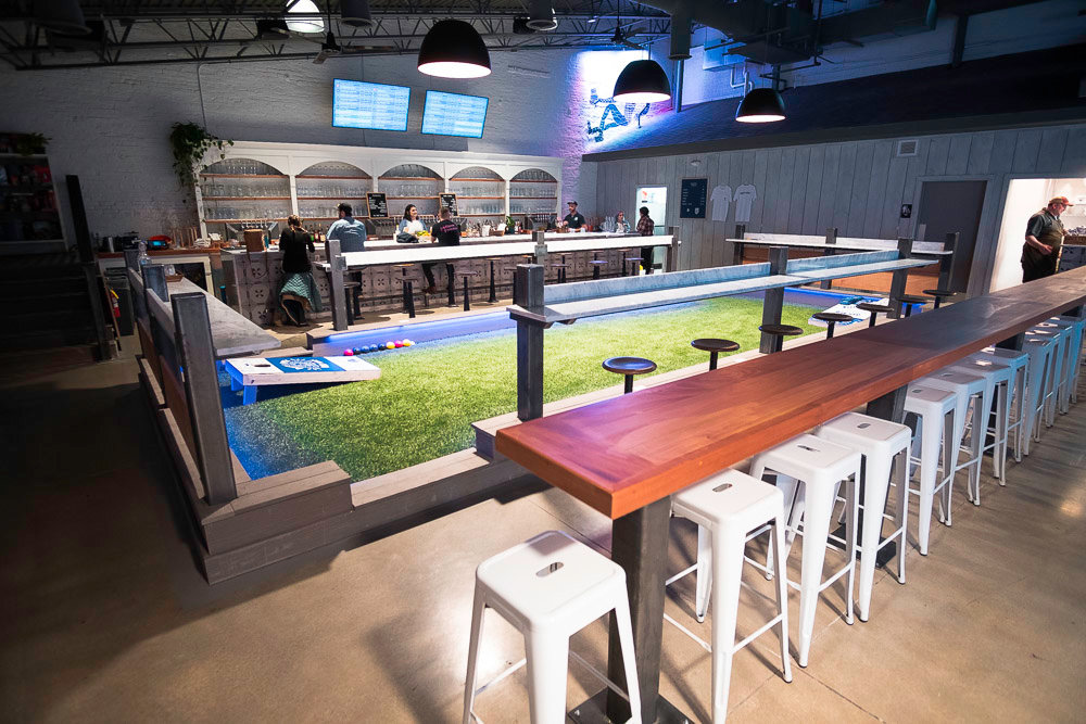 Central to Best of Luck Beer Hall is an indoor synthetic grass court.