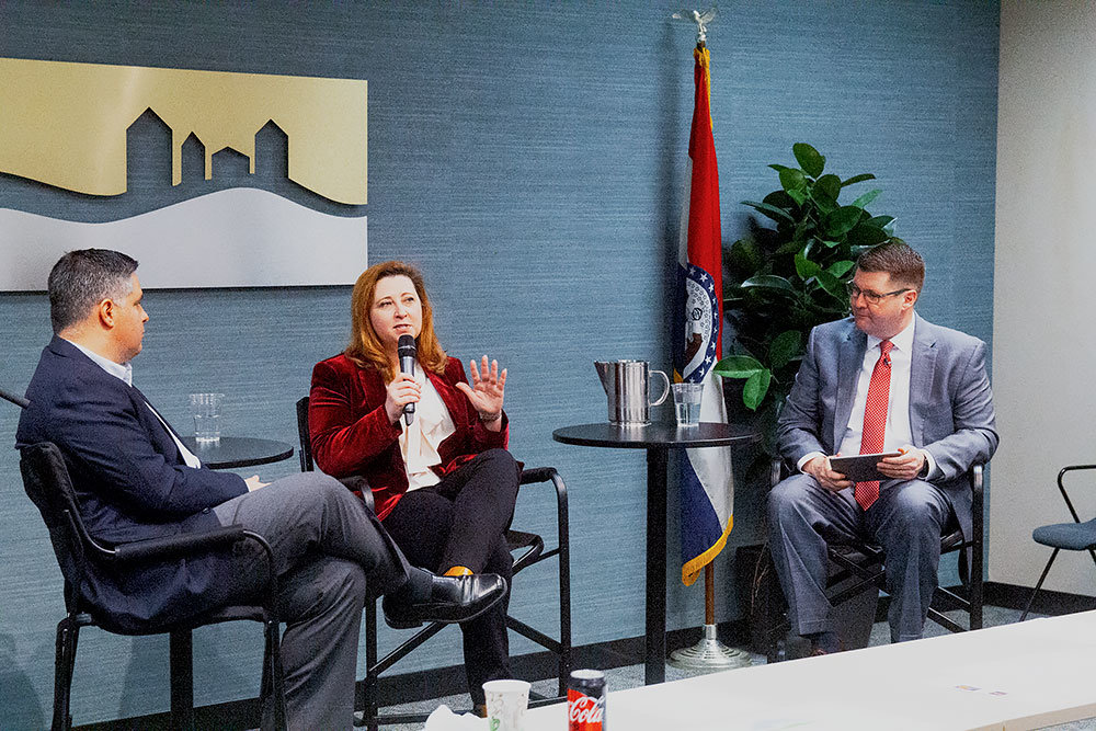 Missouri Economic Development Director Rob Dixon, left, and Higher Education Commissioner Zora Mulligan discuss workforce development with Springfield chamber President Matt Morrow on Feb. 22.
