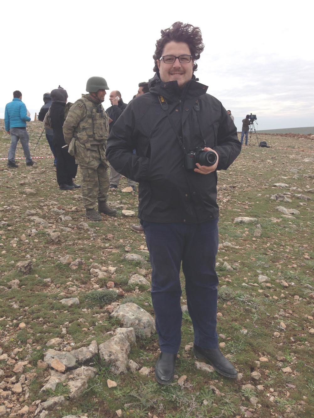 While a journalist in 2013, Omer Onder is at the Turkey and Syria border following a story about Syrian refugees entering Turkey.