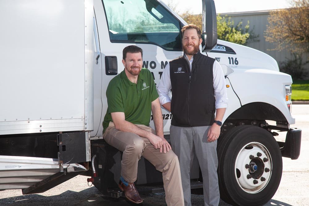 PACK IT IN: Two Men and a Truck franchisees Clint Bergman, left, and Grant Hornbuckle are eyeing new markets.