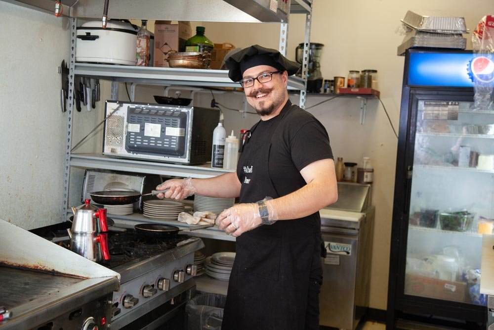 HEAD CHEF: Omer Onder frequently works solo in the kitchen at Springfield Diner.