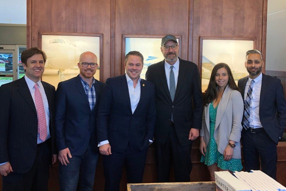 Haahr, third from left, and Rep. Travis Fitzwater, second from left, pose with Walder, third from right, and other Virgin Hyperloop officials.