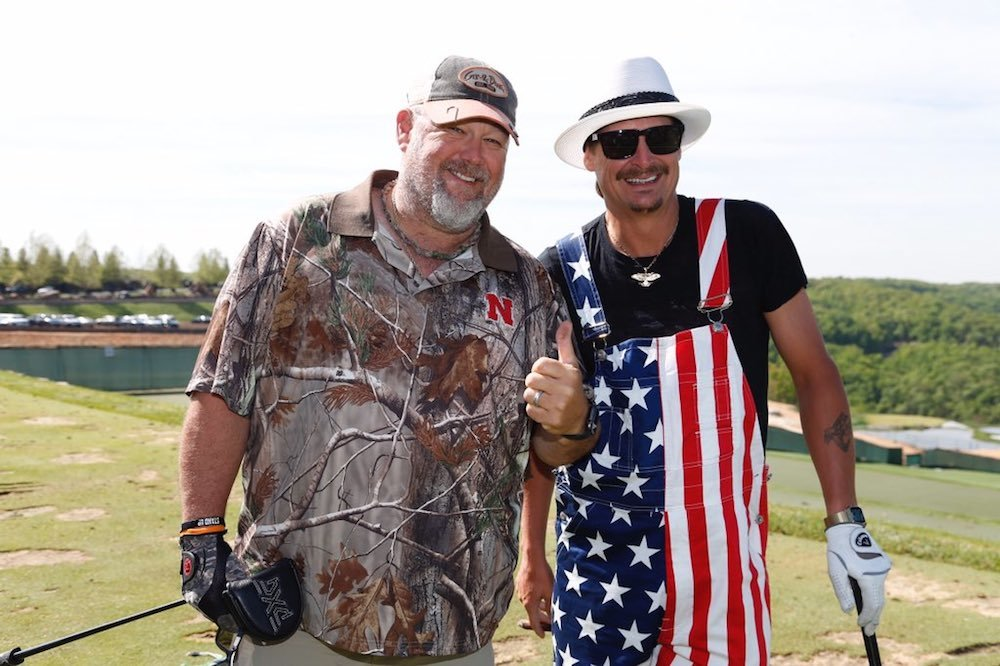 Larry the Cable Guy and Kid Rock stop for a photo amid play at Big Cedar Lodge.