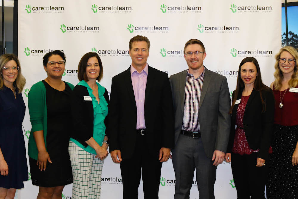 Care to Learn founder Doug Pitt and new Executive Director Christian Mechlin, center, are flanked by staff members Melissa Rea, Jhasmine Watson and Heather Trinca, on the left, and Annie Mayrose and Michelle Houghton, on the right.