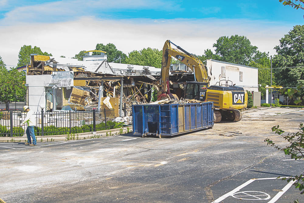 Crews work to demolish a McDonald's restaurant that's been closed for nearly a year.
