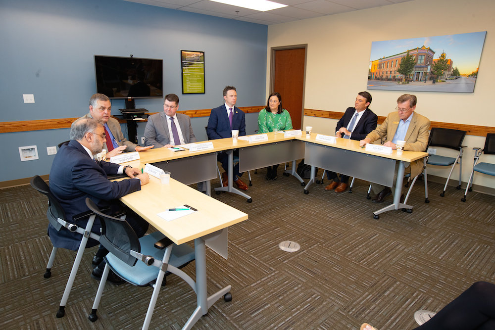 Officials participate in a roundtable discussion on Tuesday.