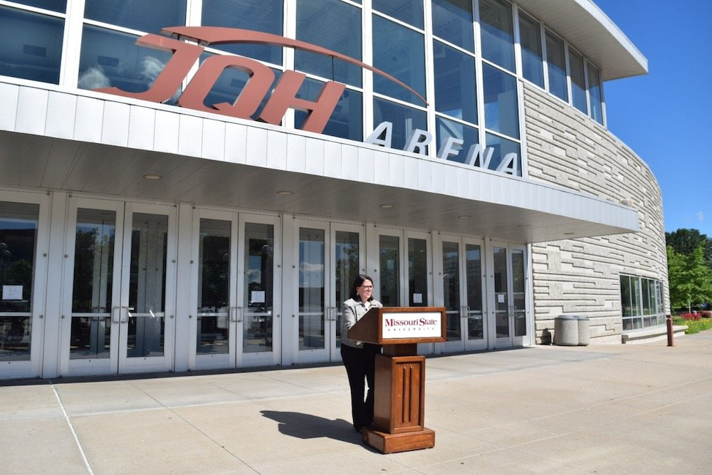 Suzanne Shaw, vice president for marketing and communications at Missouri State University, announces signage removal plans at the main entrance to JQH Arena.