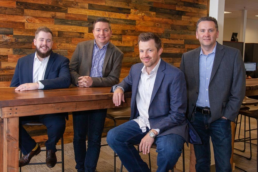 Russell Cellular is led by Jeven Russell, Nathan Mindeman, Robert Lister and Darin Wray. They're shown here in May for Springfield Business Journal's Dynamic Dozen awards.