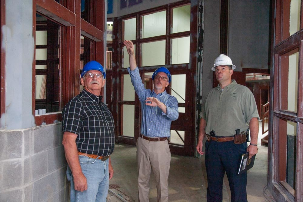 ATTENTION TO DETAIL: Stan Whitehurst, center, discusses work yet to be completed with Paul Ipock and Roye Cole.