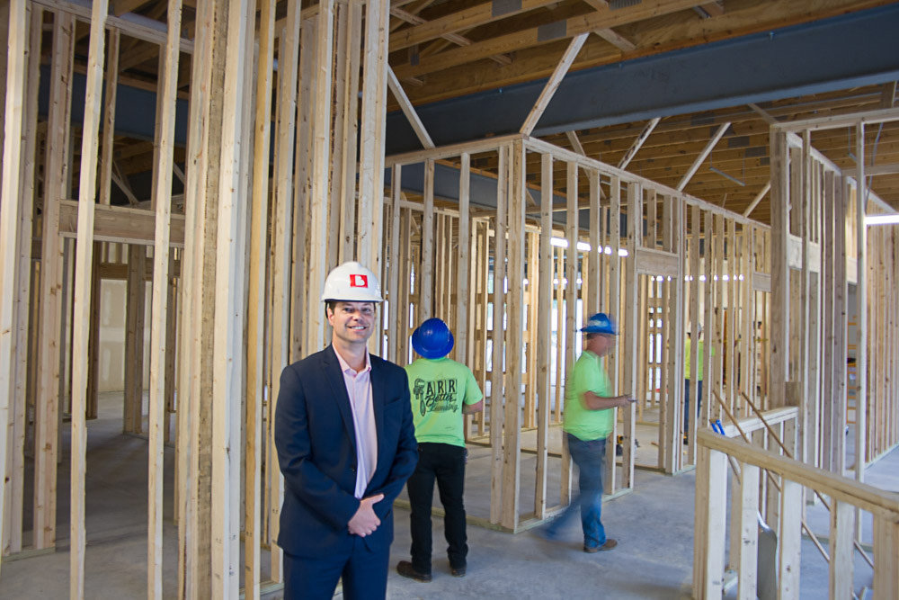 IMAC Holdings CEO Jeff Ervin checks up on construction at the Ozzie Smith clinic in the Sagamore Hill Center.