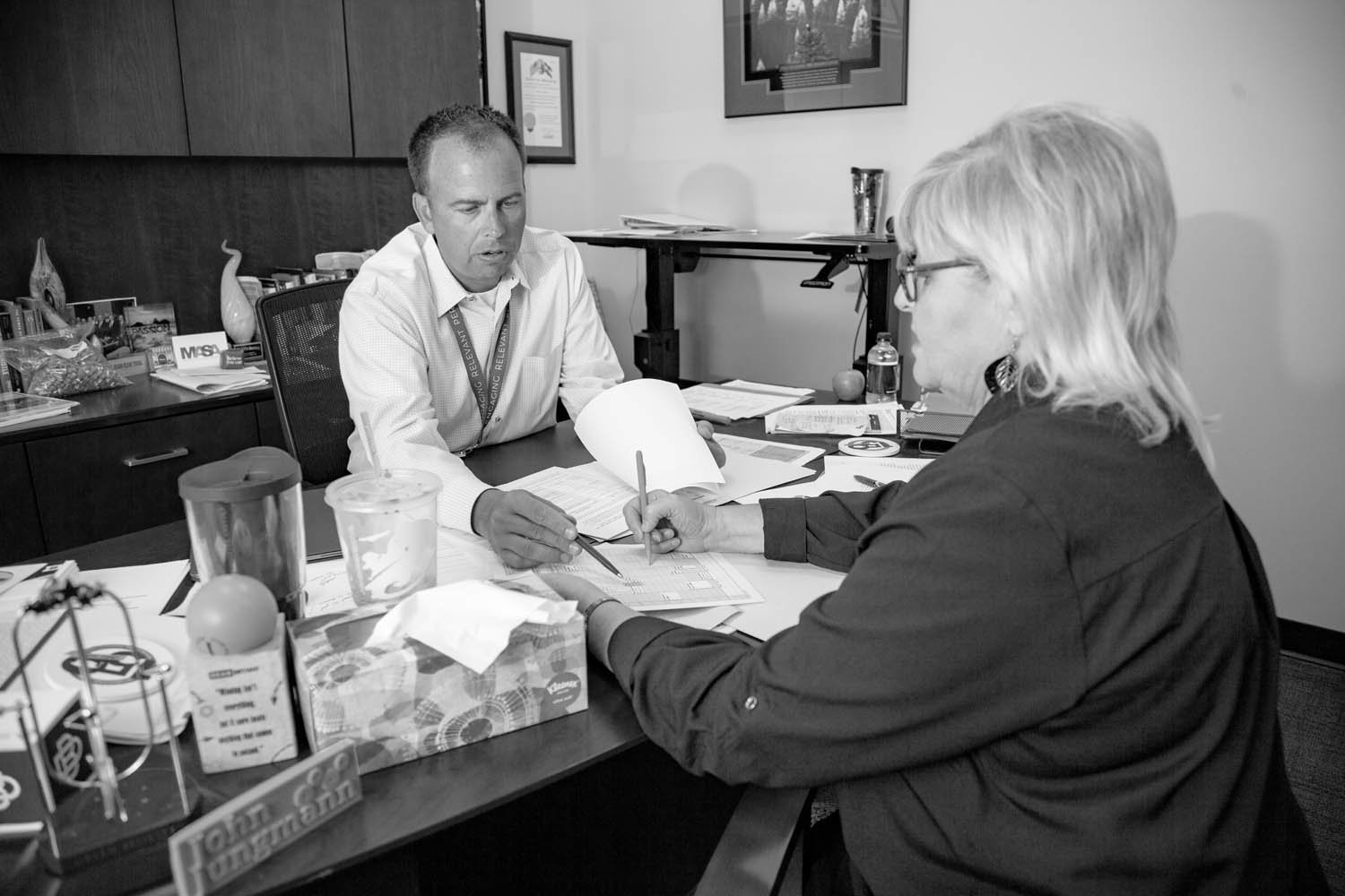 ON THE GO: Jungmann meets with Kathy Looten for upcoming travel plans. He has two work trips in July after he returns from a family vacation.
