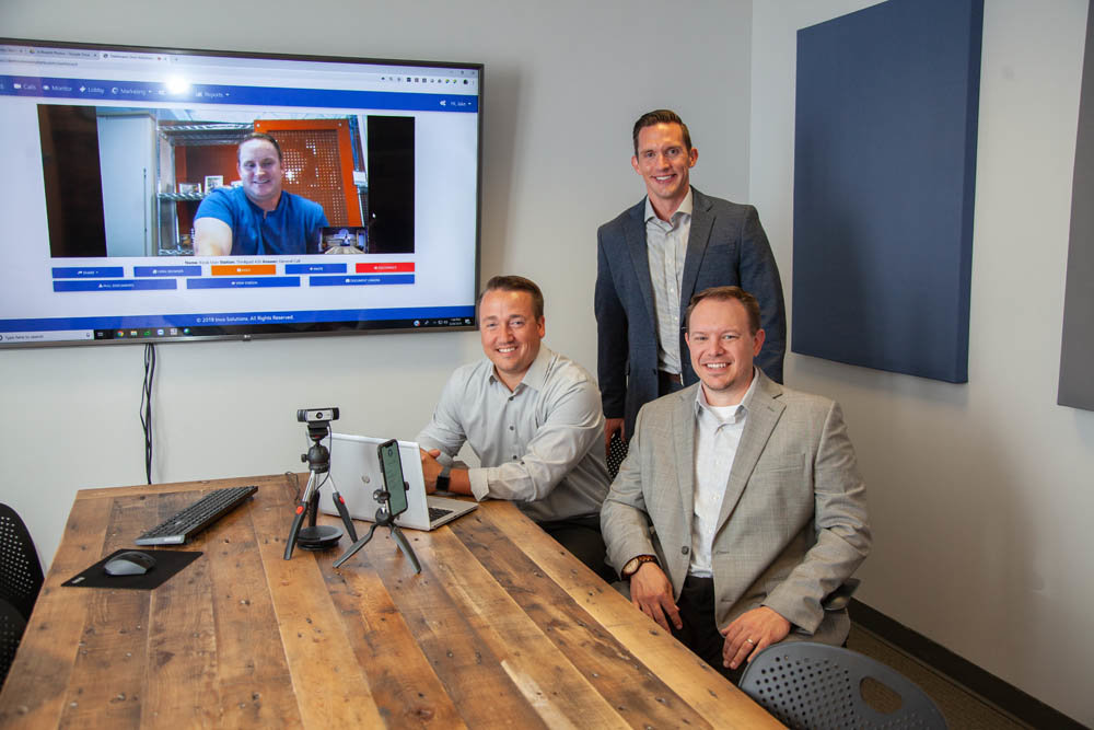THINK VERTICAL: The next step for the Invo Solutions team, James Dennis, on screen, and from left, Derek Williams, Jake Martin and Gary Kirk, is to implement their software in banks across the country. They also plan to develop software for insurance companies.