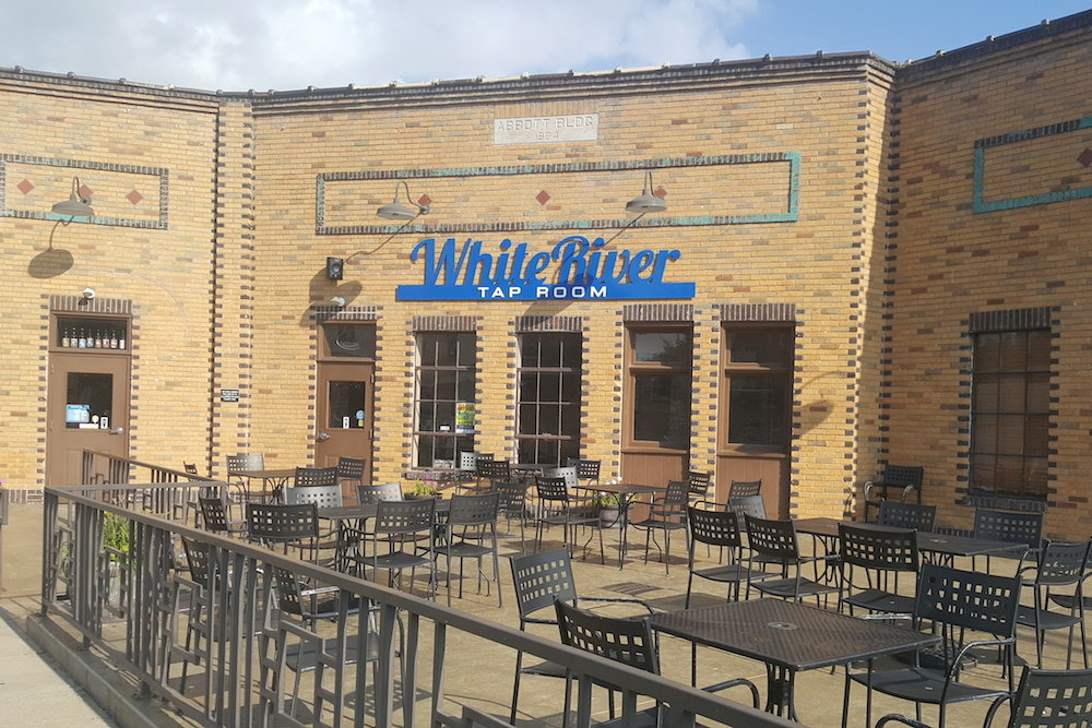 "White River Brewing Co. has continued to operate on Commercial Street after the March death of John ""Buz"" Hosfield."