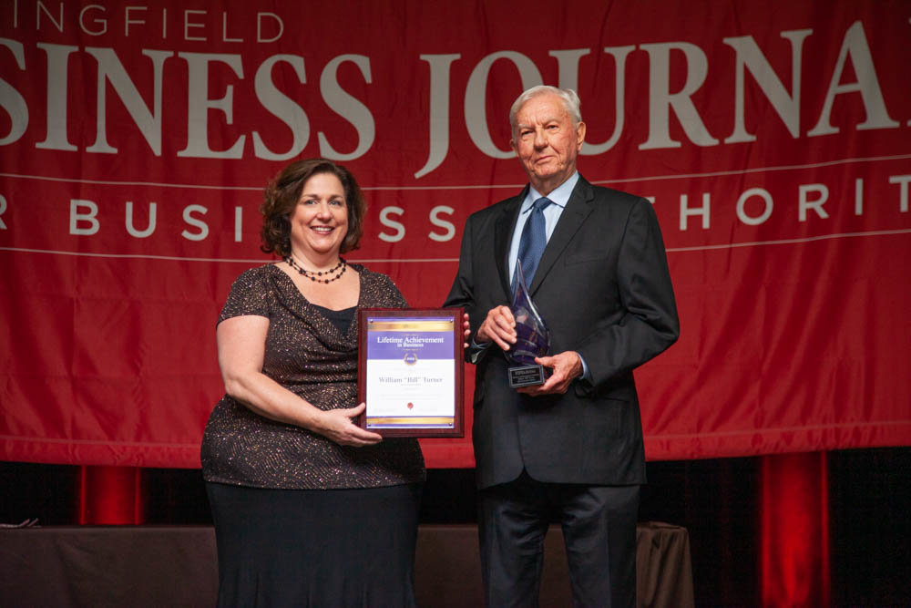 "William ""Bill"" Turner accepts the 2019 Lifetime Achievement in Business Award from Springfield Business Journal Publisher Jennifer Jackson."