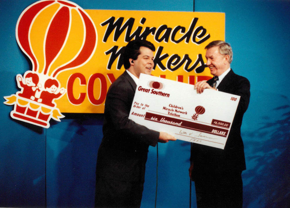 Known for his philanthropy, Bill Turner, right, presents a $6,000 bank donation to KY3's Steve Grant during a Children's Miracle Network Telethon in the early 1990s.