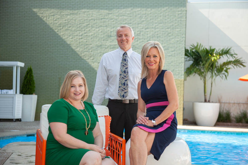 Sarah DeGuire, from left, John Blansit and Missy Handyside lead the way at Oasis Hotel & Convention Center.