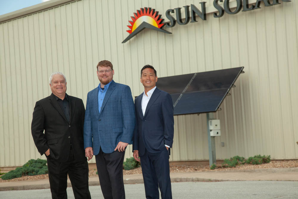 Alan Kindall, from left, Caleb Arthur and Eugene Han have helped Sun Solar install 73,000 solar panels since 2012.