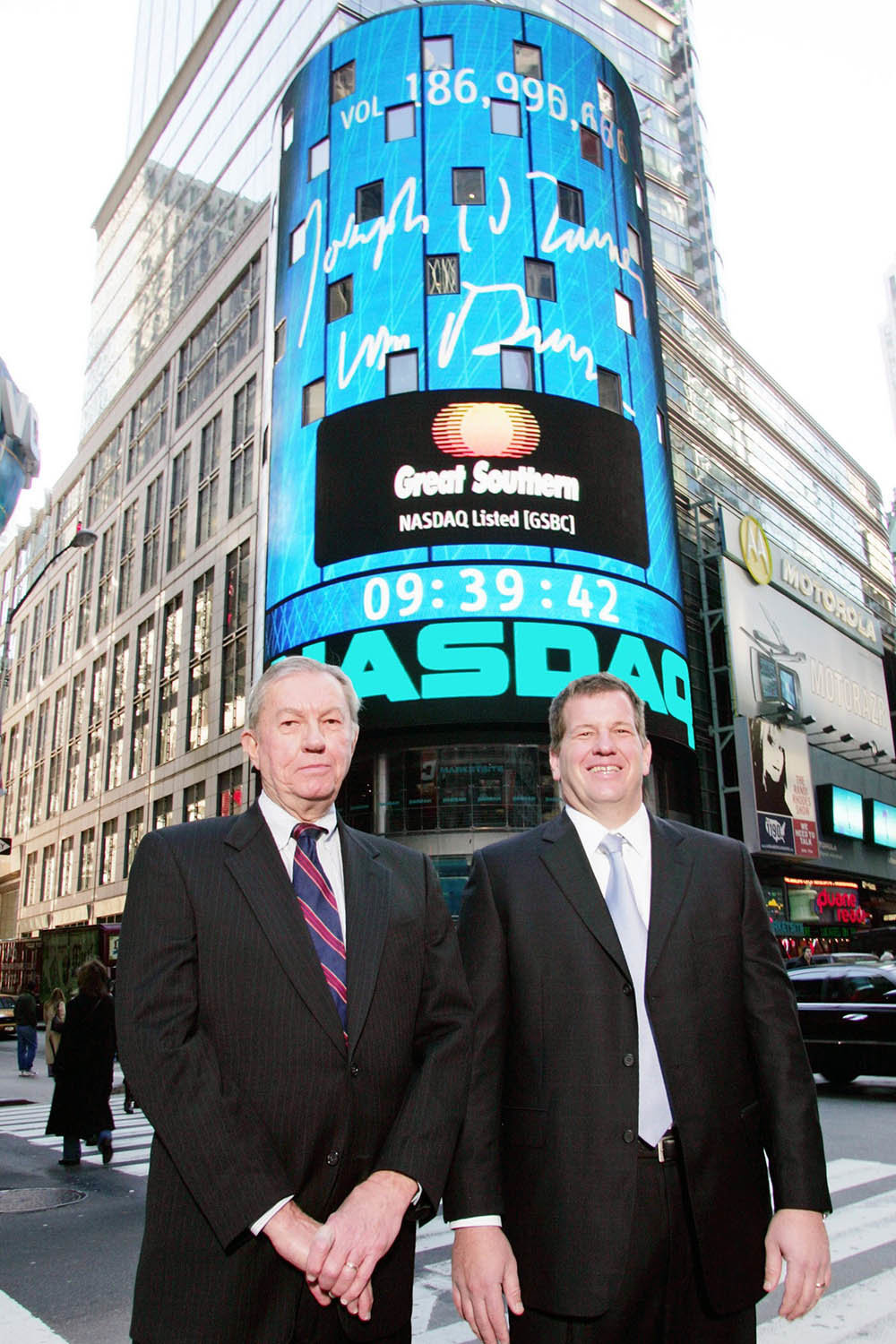 Bill Turner, left, and son Joe are in Times Square on Dec. 3, 2004, for Great Southern Bank's opening of the Nasdaq stock market.