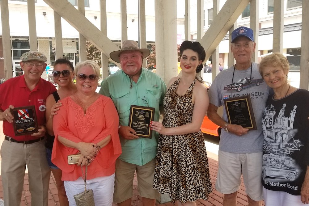 Kirk Wheeler, fourth from left, and Guy Mace, second from right, receive the John T. Woodruff Award. They're joined by family members and Miss Birthplace of Route 66 Sarah Vega, third from right.