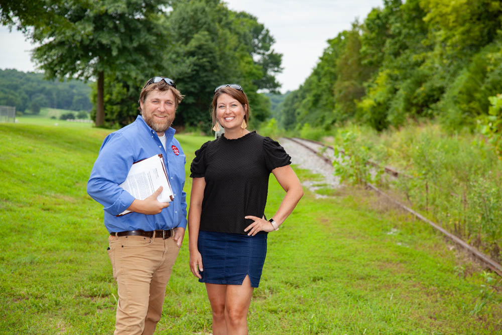 ON THE PATH: City of Ozark's Jeremy Parsons and Ozark Greenways' Mary Kromrey stand near the planned Chadwick Flyer Rail Trail intersection with the James River Greenway.