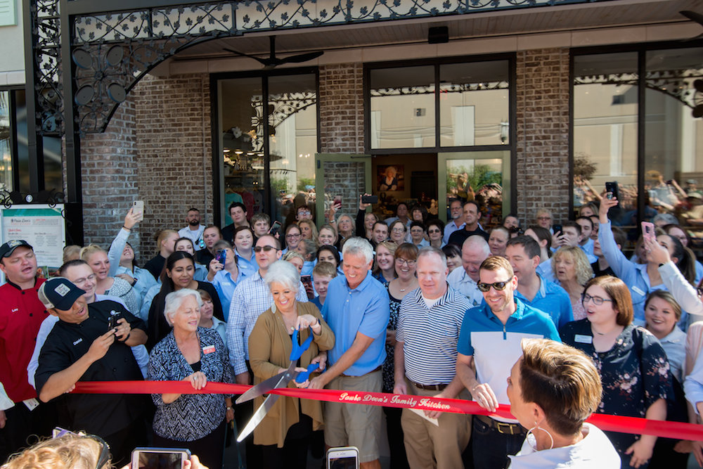 Paula Deen cuts the ribbon on Monday for a new Branson restaurant bearing her name.