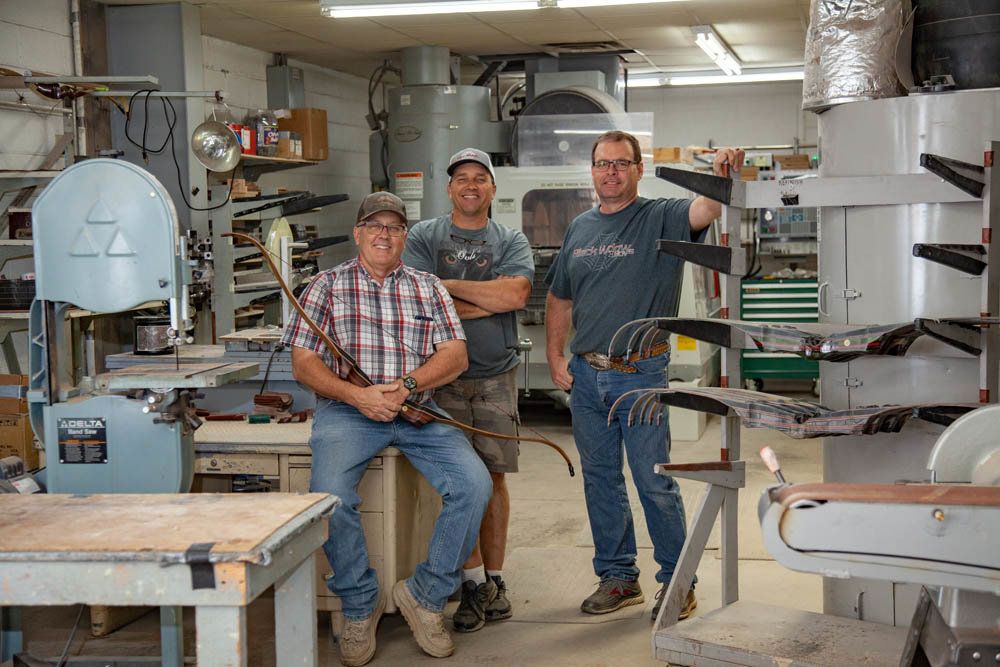 BOW BUILDERS: Owners Roger Fulton, Toby Essick and John Clayman, left to right, have led Black Widow Custom Bows since 2005.
