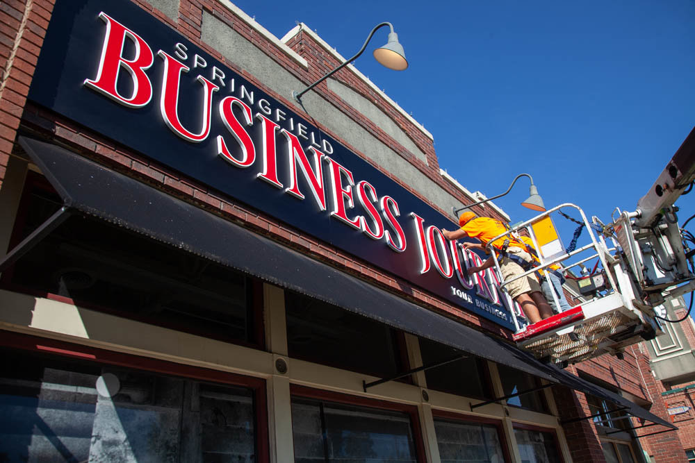 Missouri Neon Co. installs new signage for SBJ in Chesterfield Village.