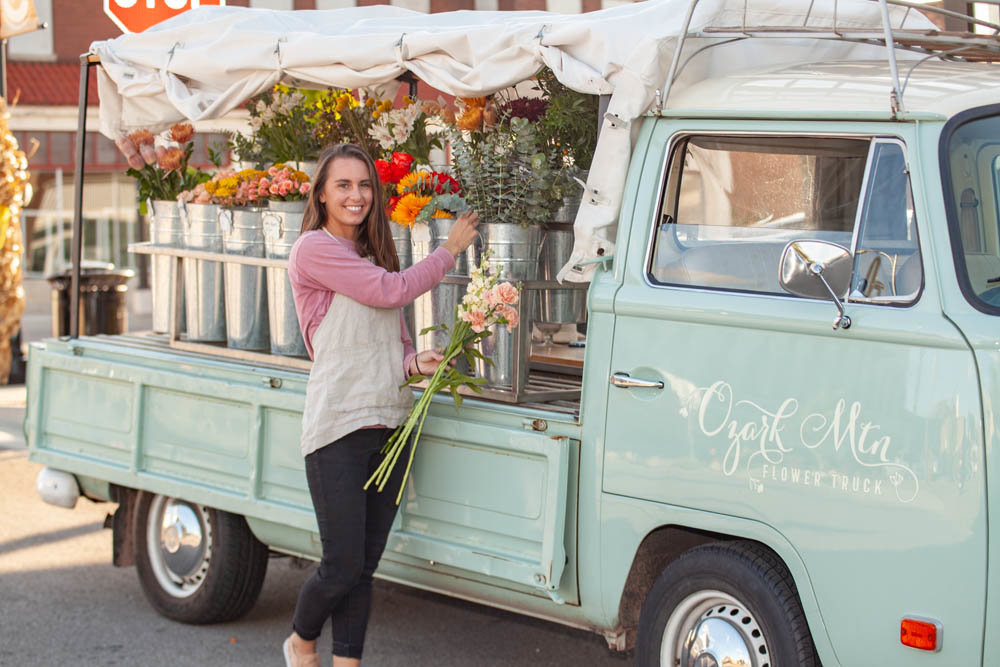 LOCALLY GROWN: The Ozark Mtn Flower Truck sets up at local businesses around town, like Eurasia Coffee and Tea, which truck owner Cassie Hartman says serves as a marketing tool for both companies.