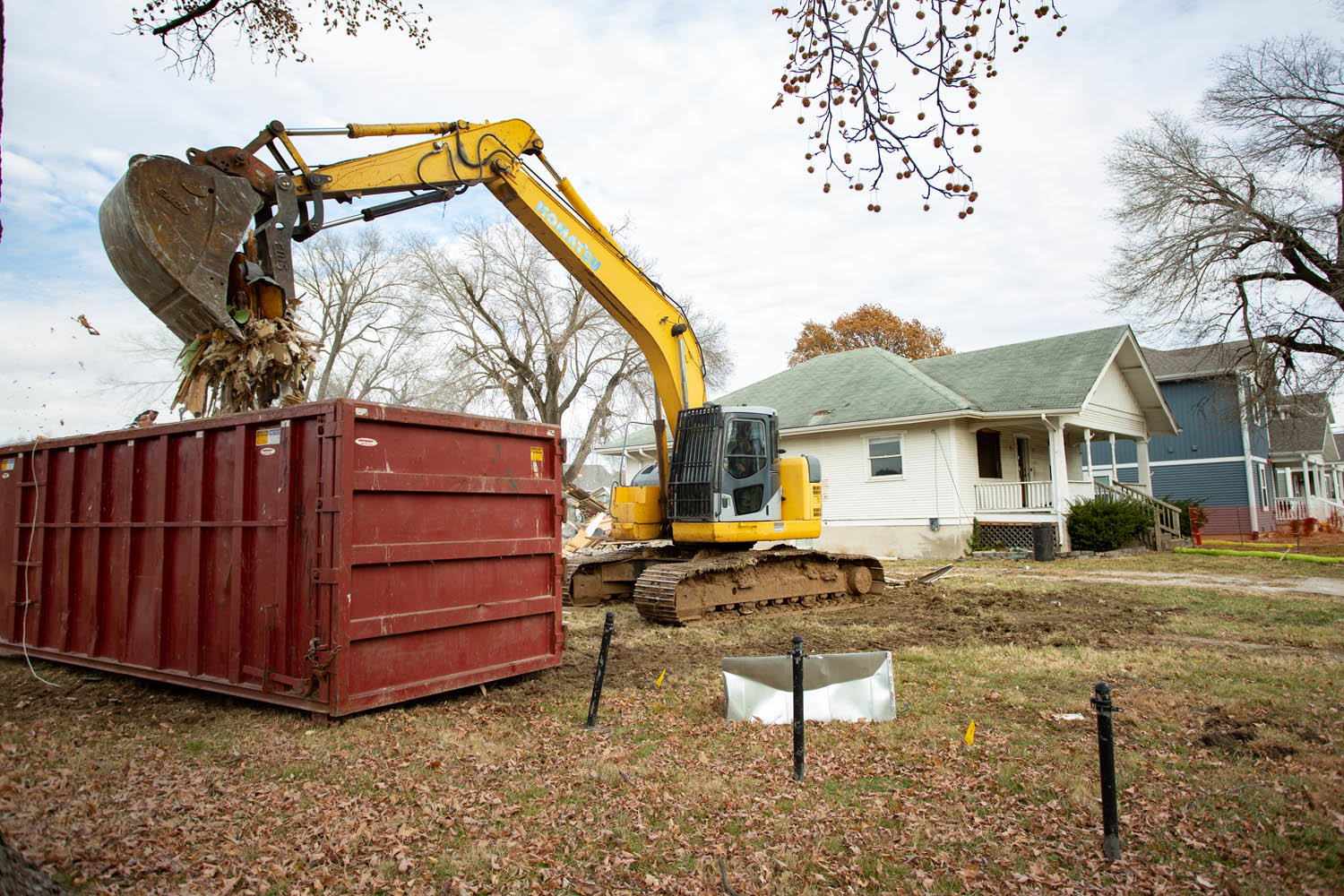 Several houses on East Cherry Street are being demolished to accommodate a residential development.