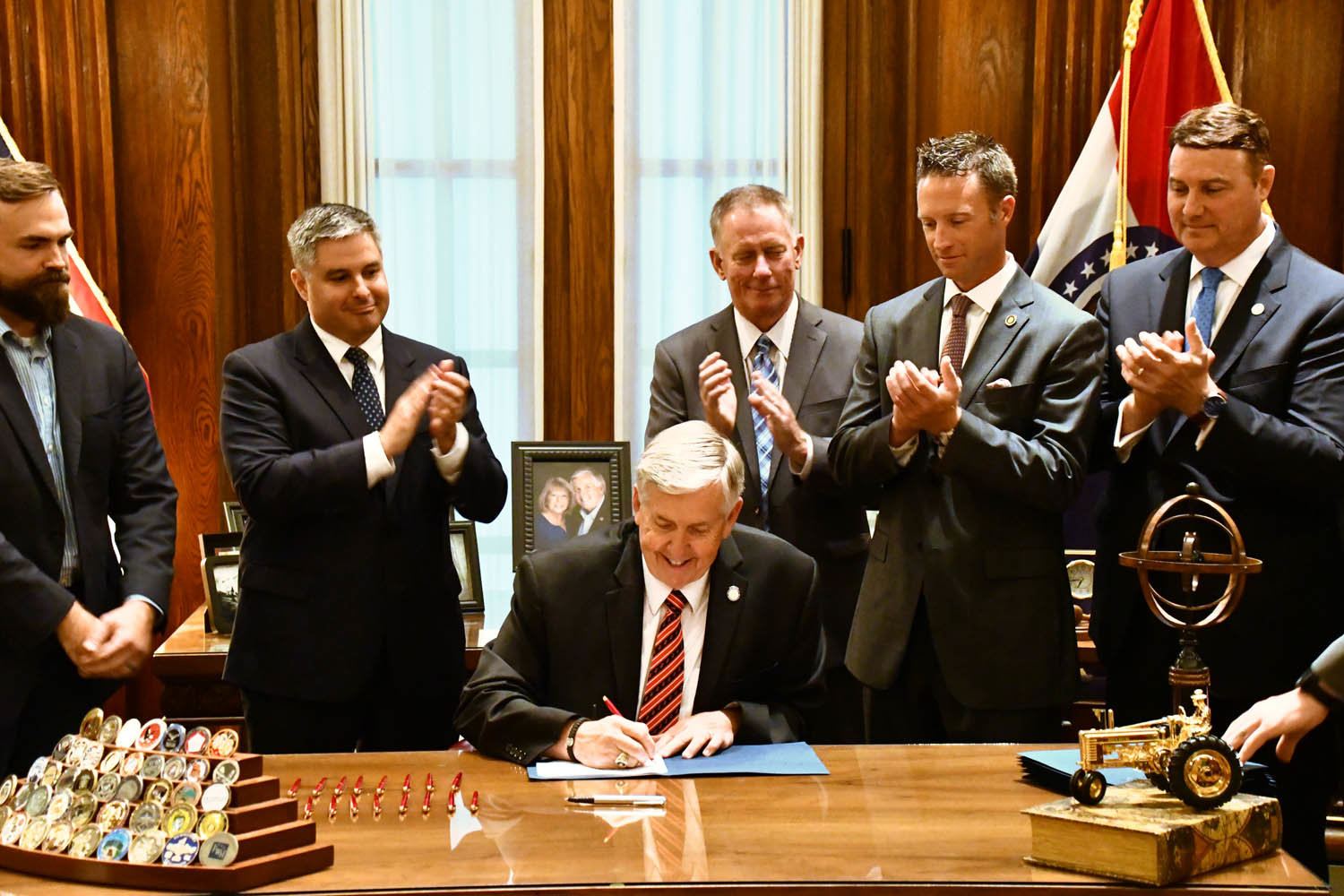 Missouri Gov. Mike Parson signs Senate Bill 68 after legislators passed it in May.