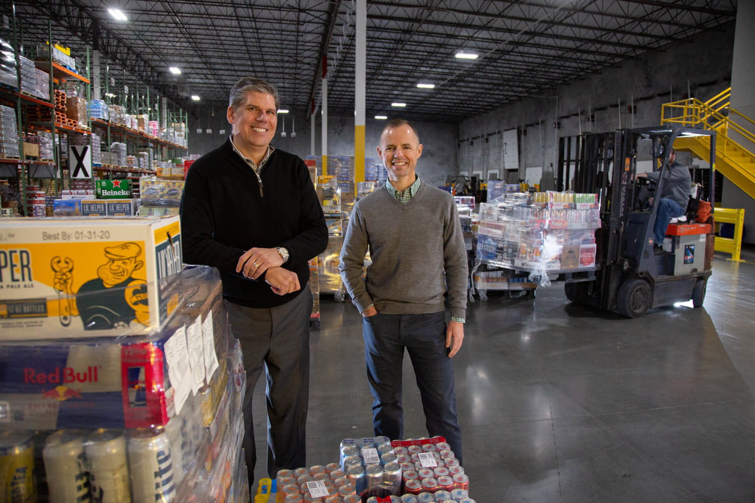 CUE THE BEER: Crews at Heart of America Beverage Co. average 385 deliveries per day, according to co-owners Brian Gelner, left, and Harwood Ferguson.