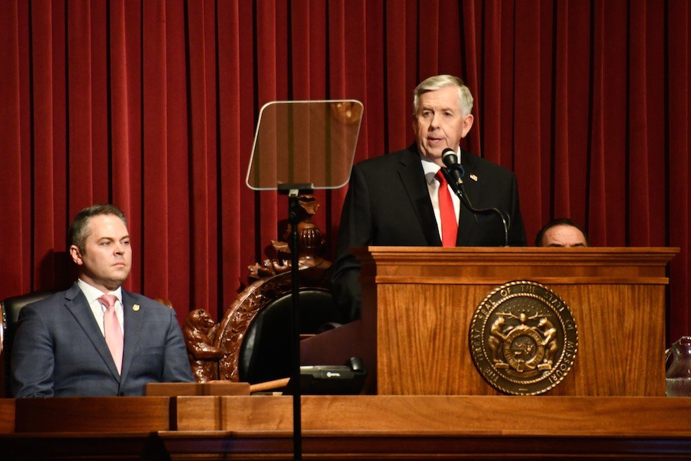 Gov. Mike Parson calls for lawmakers to set aside $100 million as a rainy day fund. At left, House Speaker Elijah Haahr, R-Springfield, listens to the annual State of the State.