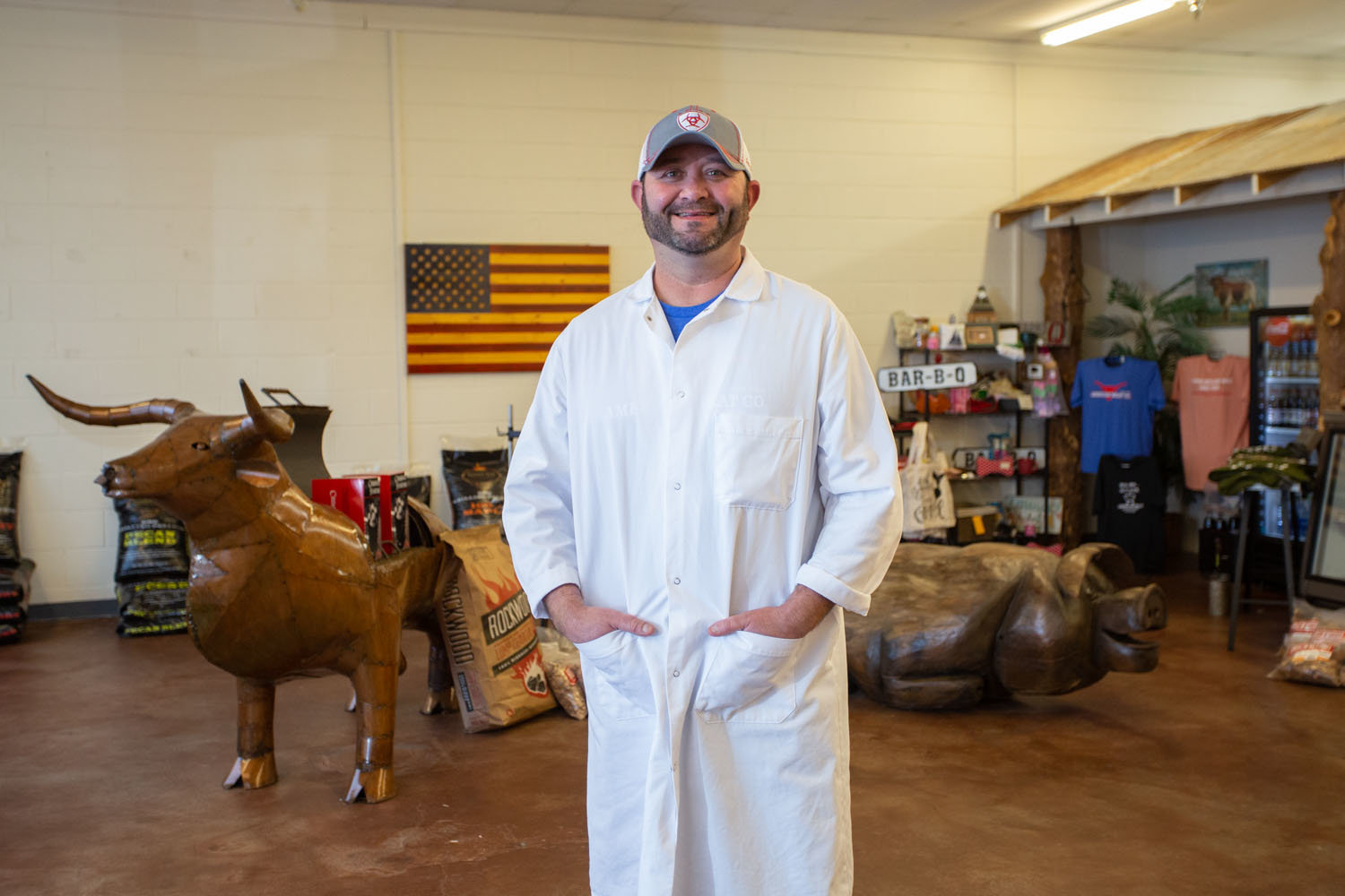 A PLACE TO MEAT: Jason Owen leads a small staff at American Meat Co., succeeding his father seven years ago as owner of the butcher shop.