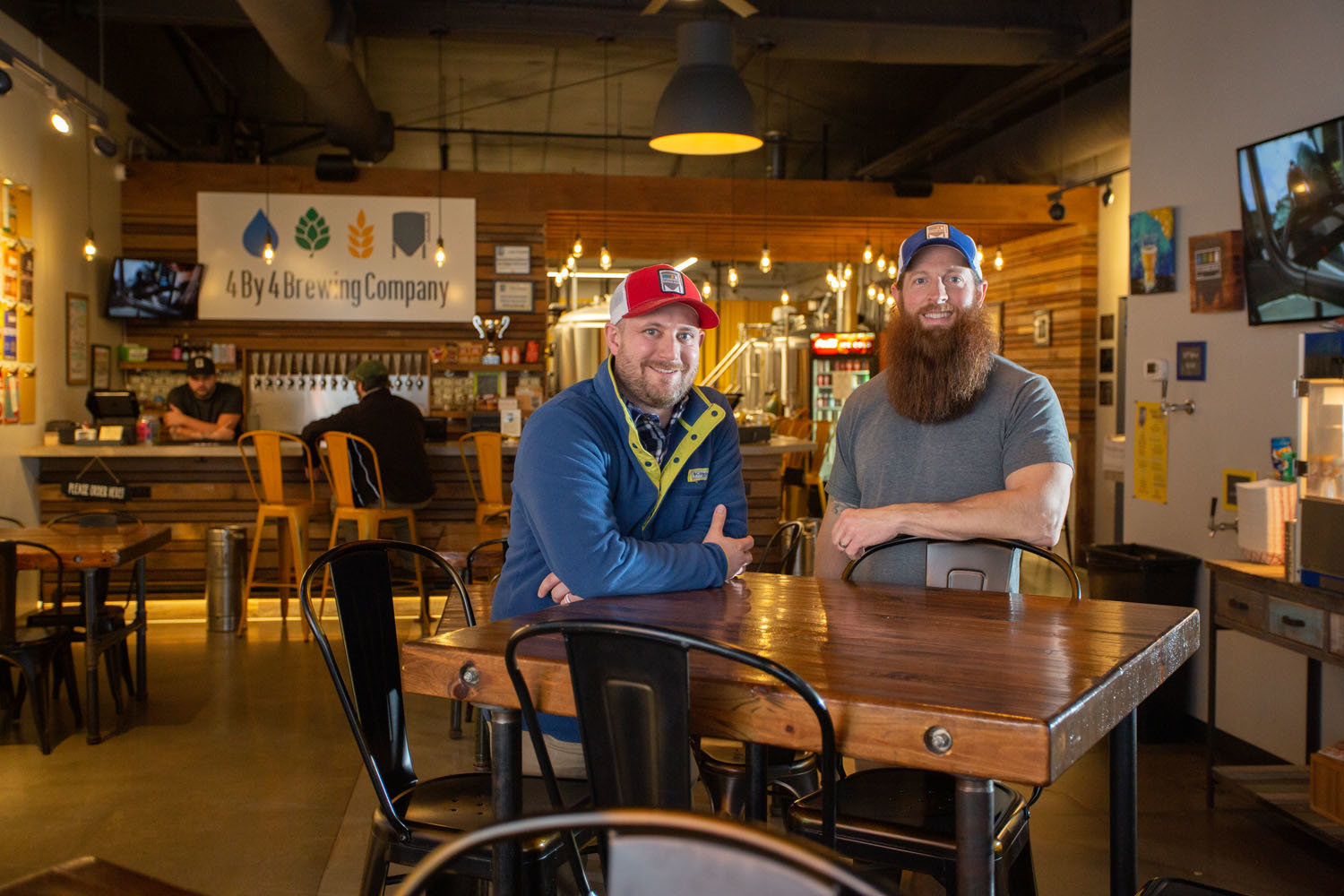 BREWING BUSINESS: Derek Shimeall, left, Chris Shaffer and the 4 By 4 Brewing Co. ownership group led the microbrewery to $800,000 in revenue last year.