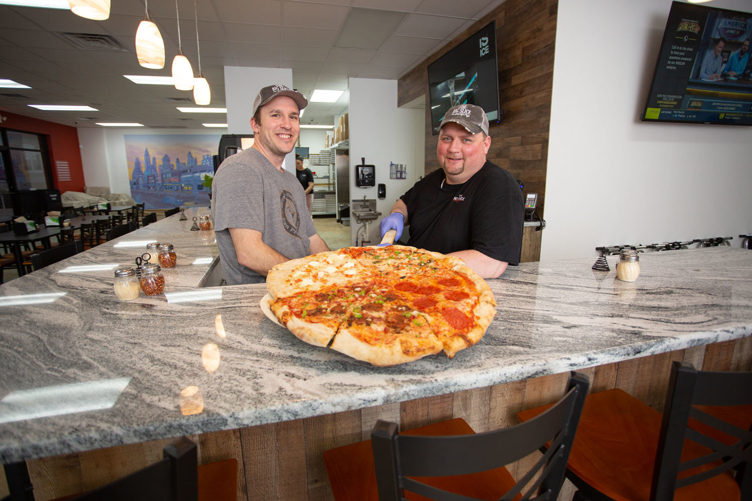 FOOD FRANCHISE: The Big Slice owner Levi Grant, left, is working to franchise the concept, starting with Justin Kennedy as a partner.