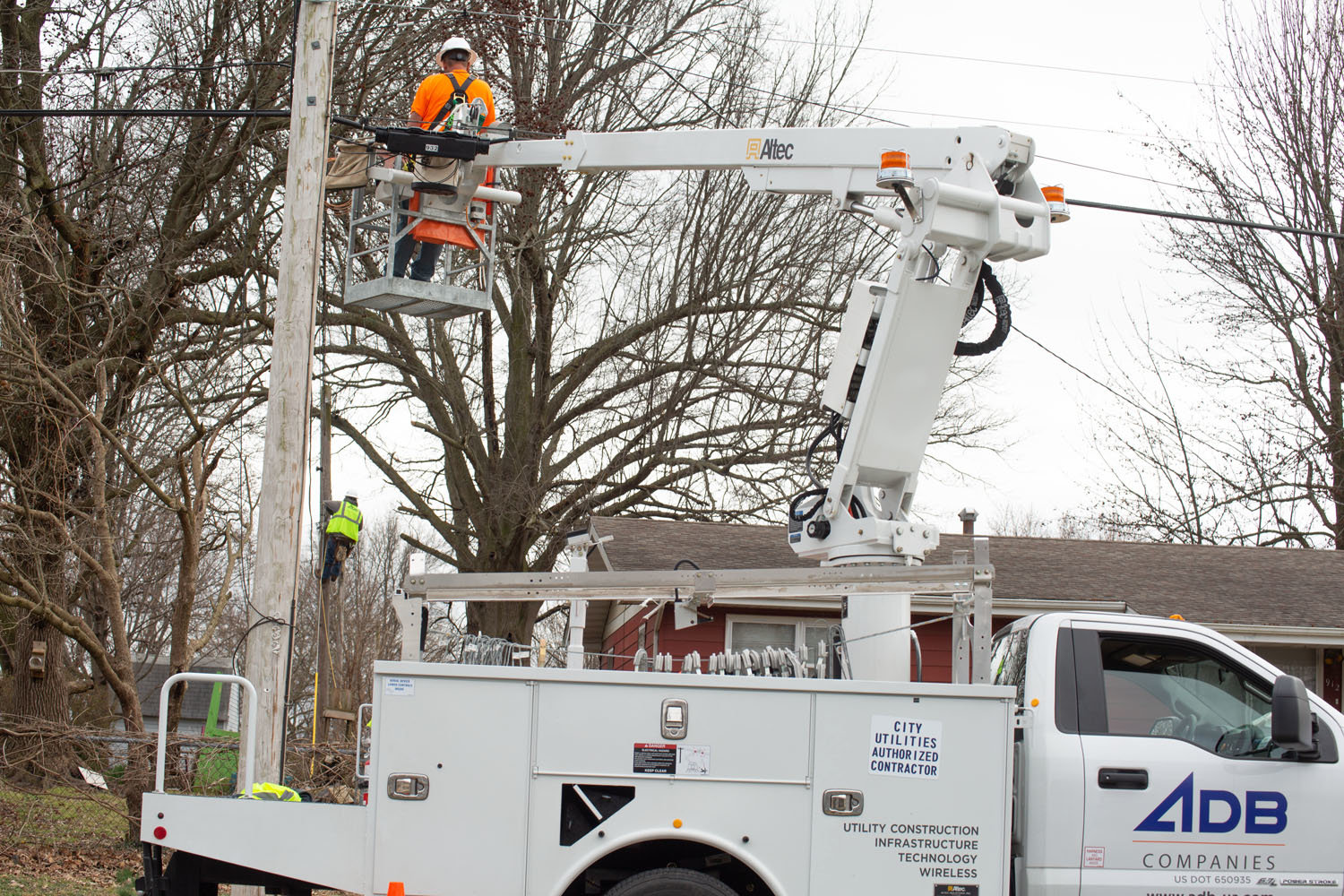 City Utilities' crews install fiber-optic lines near West Norton Road as part of a $120 million fiber network expansion.