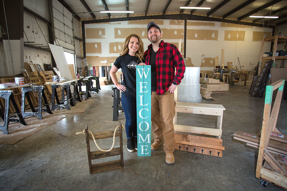 FROM SCRATCH: Aaron Black, right, and wife Jennifer sell welcome signs and wooden decor on eight online marketplaces, soon to be adding Wayfair.com.