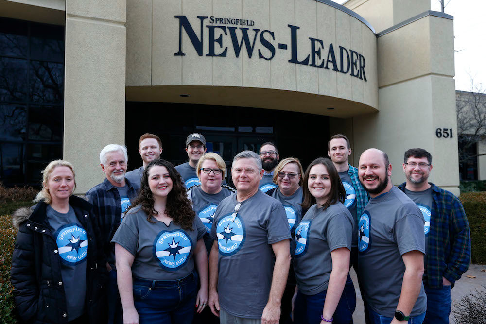 Nathan Papes, far right, front row, is one of two News-Leader workers whose employment was reinstated after Gannett Co. enacted layoffs.